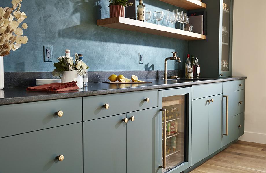 Concept 32 Custom Cabinet Studio with gray FENIX NTM cabinetry, dark countertops, sink, wine glasses and drinks fridge