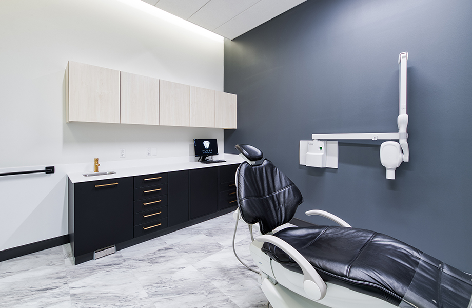 Floss Dentistry exam room with dentist treatment chair and black and white cabinets