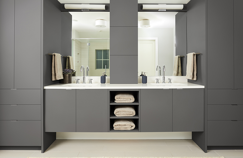 Modern bathroom with double sinks and Grigio Bromo gray matte flat-front cabinetry