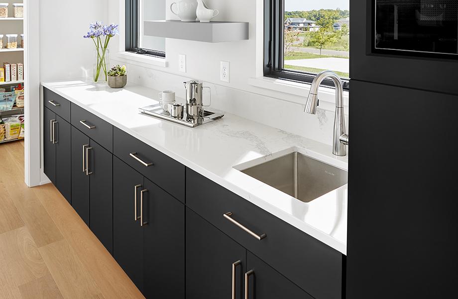 Modern kitchen with white countertops, sink, window and J0720 Nero Ingo J0725 Grigio Efeso black kitchen cabinets