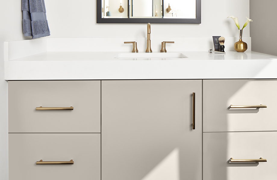 J0748 Beige Arizona super-matte bathroom cabinets with white countertop and gold fixtures